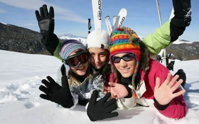 Happy girls with clothing purchased at the San Rocco store in Livigno